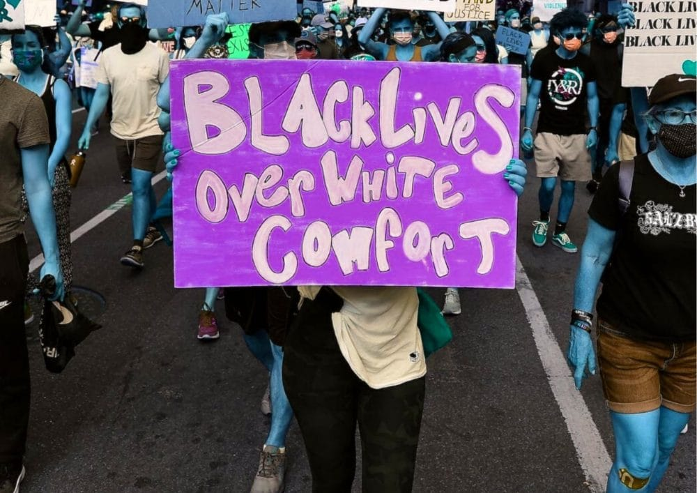 A sign read Black Lives over White Comfort